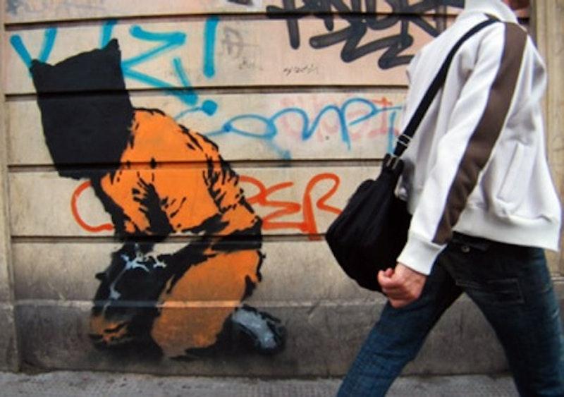 Banksy gitmo.jpg?ixlib=rails 2.1
