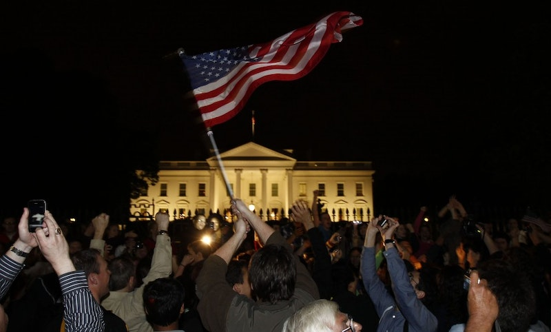 93716 people cheer and wave u s flags outside the white house as president b.jpg?ixlib=rails 2.1