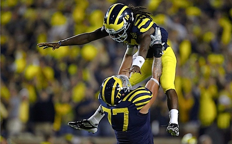 Michigan forgets everything it knows about football and lets denard robinson take it from there.jpg?ixlib=rails 2.1