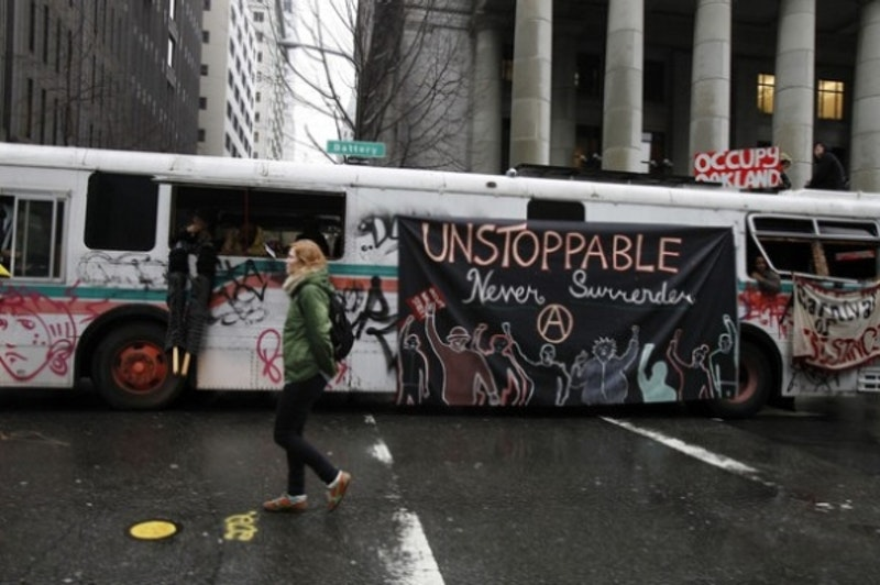 Occupy oakland fuk the police anarchist symbol banner on oo occubus 1 20 2012 2.jpg?ixlib=rails 2.1