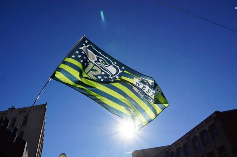 Seattle victory flag raised at the super bowl parade in downtown seattle 0.jpg?ixlib=rails 2.1