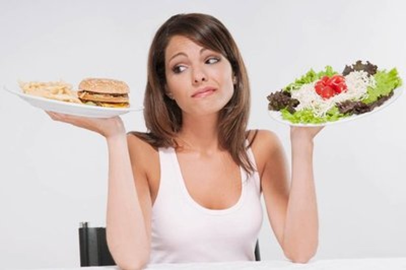 Rsz woman choosing between a hamburger plate and a salad plate.jpg?ixlib=rails 2.1