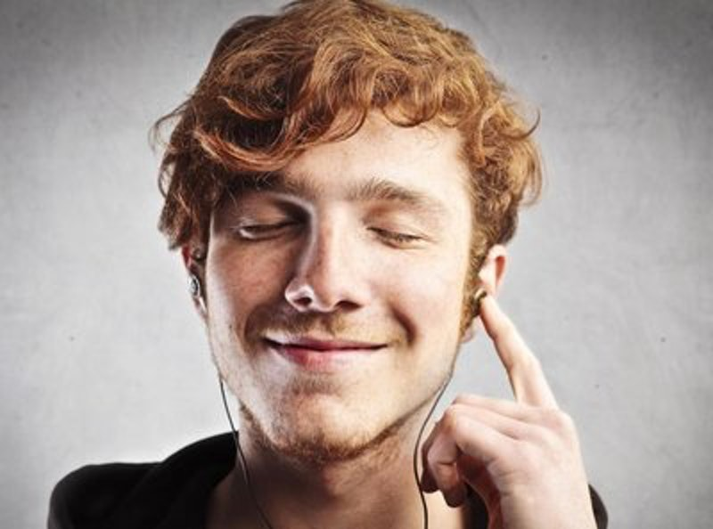 Rsz red haired man smiling while listening to music.jpg?ixlib=rails 2.1