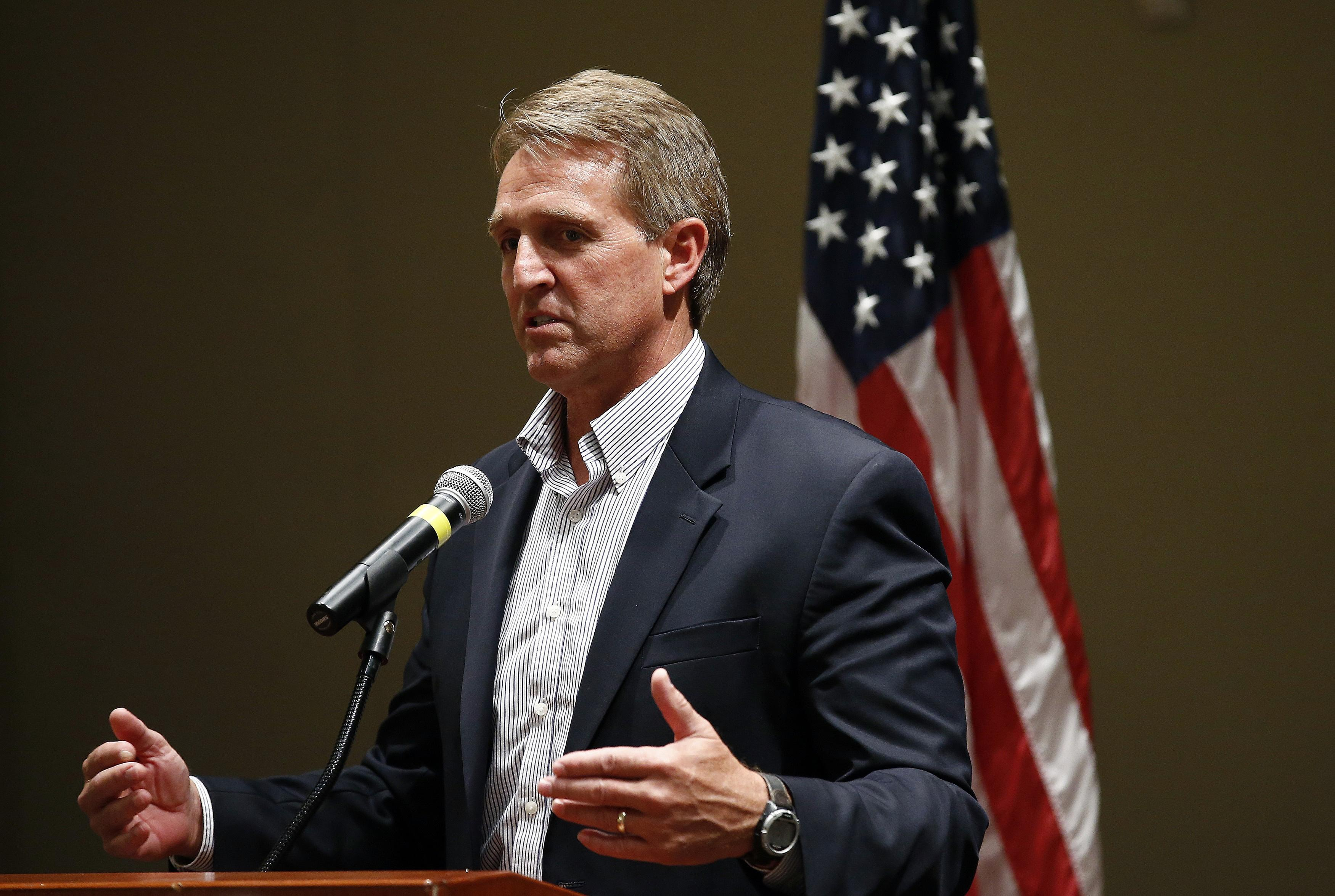 Republican Sen. Flake faults GOP, Democrat partisanship for Trump rise
