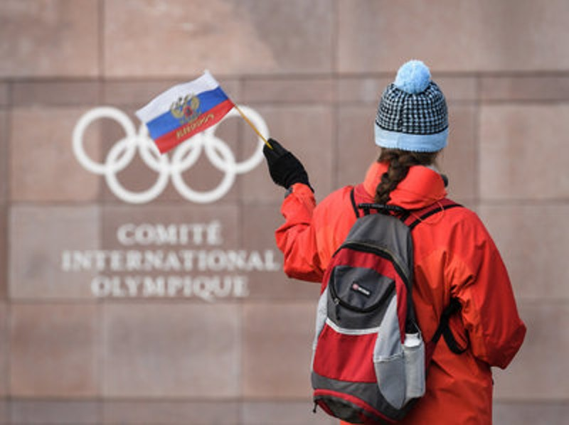 Rsz http   oaolcdncom hss storage midas af4855581db7ff0af13446252d5696a2 205923078 supporter waves a russian flag in front of the logo of the olympic picture id886266270.jpg?ixlib=rails 2.1