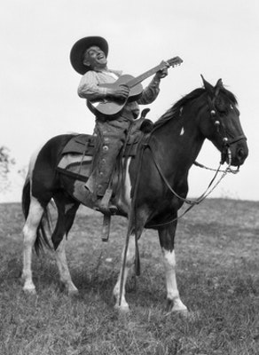 Owdr 1920s cowboy on horse singing and playing guitar.jpg?ixlib=rails 2.1