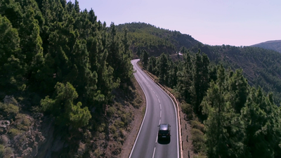 Videoblocks aerial silver car driving on a lonely mountain road through the pine tree forest hkrszsrug thumbnail full02.png?ixlib=rails 2.1