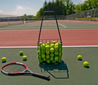 Court racquet and basket of balls src img getty.jpg?ixlib=rails 2.1